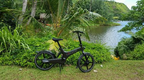 Image of a GoCycle bike parked in front of beautiful scenary